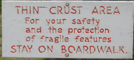 sign thin crust area: warning sign at Yellowstone thermal basin: thin crust area