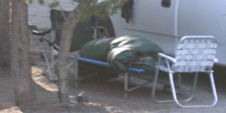 sleeping out on a cot: