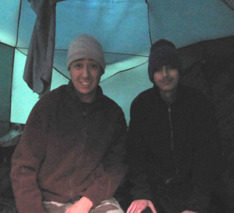 snow camp 2015 2 people: people in a tent first thing in the morning