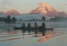 tetons sunrise reflection in ripples misty: