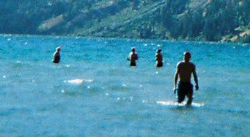 swimming Leigh lake 2008 by mark nevill: four people swimming, well in this picture standing, in Leigh lake 2008. Photo by mark nevill.