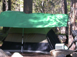 tent with tarp set up overhead:
