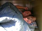 two sleeping in bear box: