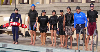180 pixel rash guards: eight people standing on a pool deck, wearing rash guards