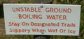 yellowstone warning sign unstable ground stay on trail: