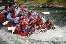 whitewater rafting by Ron Niebrugge: people in a raft, the front of which is partially submerged in white water, used with permission from the photogrpher, Ron Niebrugge
