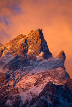 Grand teton sunrise by Ron Niebrugge: bright clouds behind the top of the Grand Teton peak, used with permission from the photographer, Ron Niebrugge