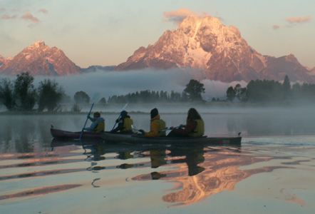 2005 oxbow bend pink sunrise kayaking into mist.: two kayaks with a pink sunrise and mist