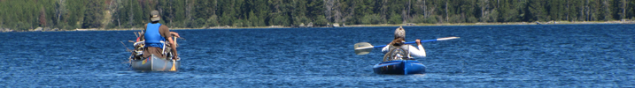 Alexander Mitchell and Alanna Klassen paddling: canoeist and kayaker on large lake