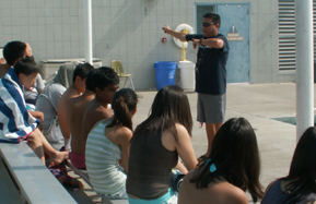 Coach Lugo EAP plan: Coach Tim Lugo addresses his swim students about the class emergency action plan
