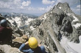 Mountain climbingTetons NPS photo: two climbers with helmets sit on a peak, photo courtesy of the national park service