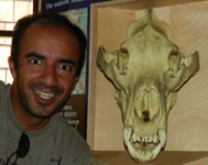 Rajiv and skull: wide-eyed grinning man next to skull