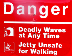 danger deadly waves at any time: a sign that says danger deadly waves at any time, jetty unsafe for walking