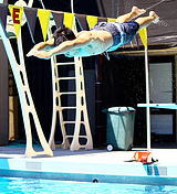 photo by Joyce Kuo diver summer PE 26C D class De Anza College: a diver takes off from a three meter diving board, caught in mid air