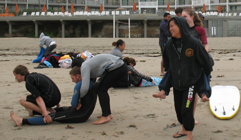 front and back carry at beach 2010: beach in front of hotel with various lifeguard students practing a carry