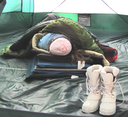 2010 winter trip girl in tent with multiple sleeping pads and bags: posed photo of girl in a huge tent with multiple sleeping pads under her and three sleeping bags