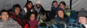 group in tent winter 2013: a bunch of people sitting up in their sleeping bags in a tent