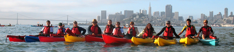 lifeguard group photo on bay 2010 alcatri: row of kayakers on San Francisco bay with skyline in background