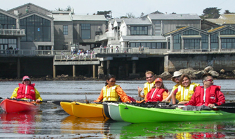may 2005 De Anza College ocean kayakers with mb aquarium behind them: