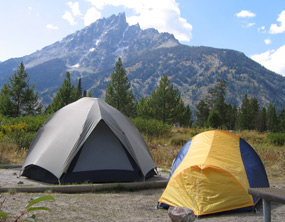 nps photo Jenny Lake campground: campsite with two tents, mountain in background