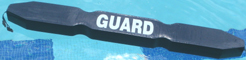gray rescue tube diagonal on pool surface: gray rescue tube diagonal on pool surface