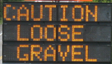sign caution loose gravel: sign caution loose gravel