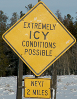 sign extremely icy conditions possible next 2 miles: sign that says extremely icy conditions possible next 2 miles