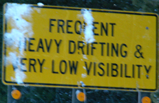 sign frequent heavy drifting: a road sign that says frequent heavy drifting (of snow) can be expected