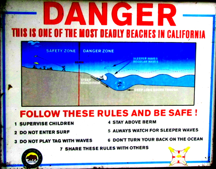 sign one of the most dangerous beaches: a sign that says Danger this is one of the most deadly beaches in California