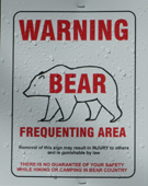 sign warning bear frequenting area: