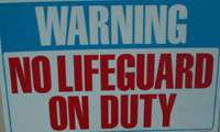 sign warning no lifeguard on duty: