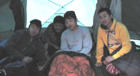 snow camp 2015 four people in tent.: sleepy people in a tent first thing in the morning