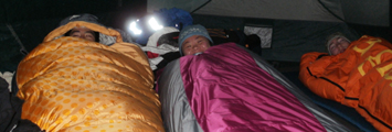 three in tent winter 2013 yosemite: three people in sleeping bags in a tent just waking up