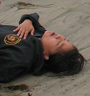 waterfront guard practice victim: waterfront guard practice victim pretending to be unconscious on a beach