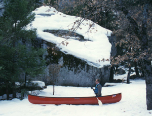 canoe in the snow: Would you believe white-water canoeing?  (Note that he has his life-jacket on!)
