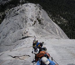 line of people holding on to Half Dome cables