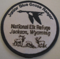 a cloth badge that says Junior Blue Goose ranger, National Elk Refuge, Jackson, Wyoming