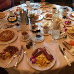 many plates of food on a large round table