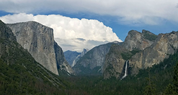 NPS photo of Yosemite valley including El Capitan, Half Dome, Bridalveil Fall and a mass of clouds