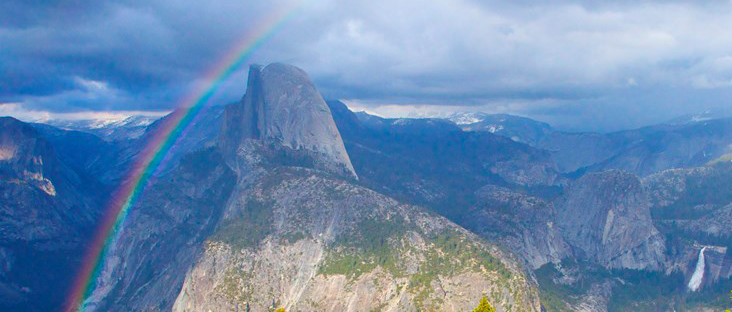National Park Service photo of a rainbow over half dome