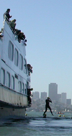 athlete caught in mid air jumping off a ferry