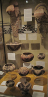 a glass case with Indian baskets
