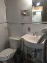 toilet and sink in cabin