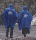 two people wearing Yosemite logo rain ponchos