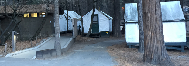 canvas tent cabins and a restroom building