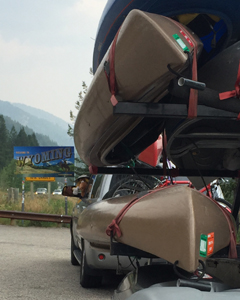 kayaks on trailer , Bullwinkle trip mascot and Wyoming Welcome sign