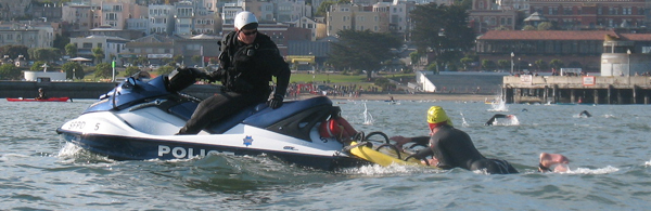 police officer on a jet ski with a swimmer he is assisting