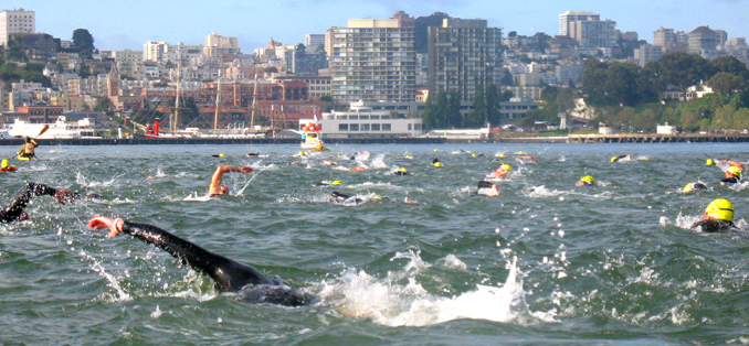 swimmers in San Francisco bay, Aquatic park in background