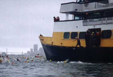 swimmer jumps off a ferry