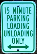 sign that says 15 minute parking loading unloading only